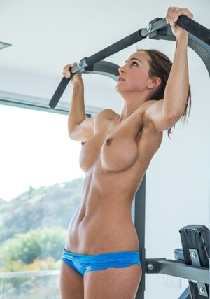 Tanned Soccer mom slowly takes off her outfit during sweaty workout in empty gym