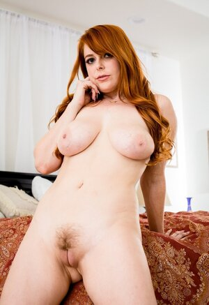 Tattooed guy gets love pole out of buxom redheads honey pot and moreover cums on hairy pubis