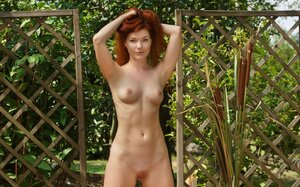 Hot 18-19 y.o. chick with long fire-red hair swings and plus gets naked on a red carpet