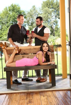 Girl in a pink dress makes boyfriend drink wine with friend to see them kissing