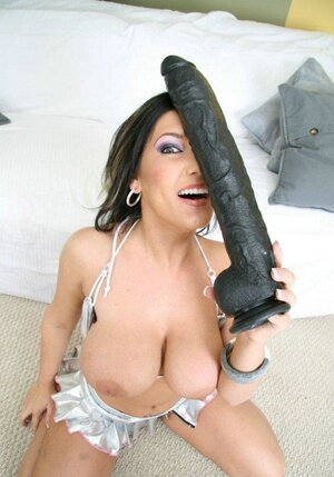 Brunette gal with huge breasts found a matching black vibrator for her pussy