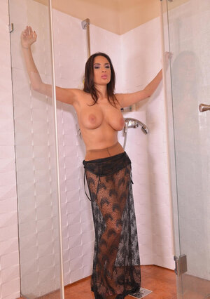 Tempting dame takes a shower washing breasts and masturbating with water jet
