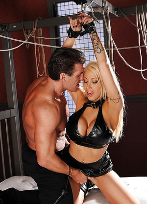 Pumped up master takes off handcuffs giving the blonde opportunity to suck cock